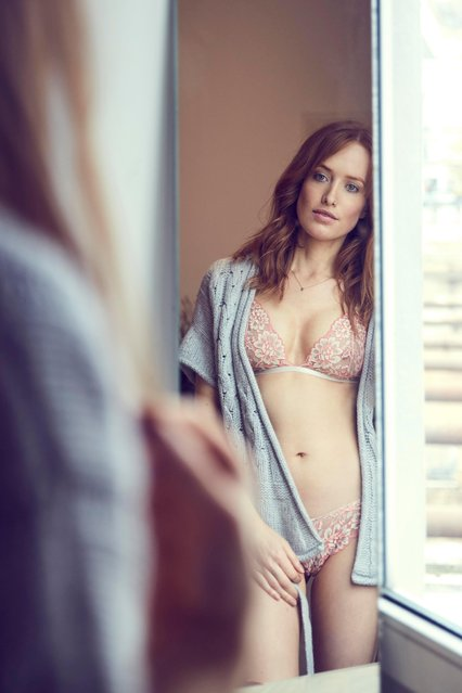 Mirror image of redheaded woman wearing lingerie watching herself. (Photo by Westend61/Getty Images)