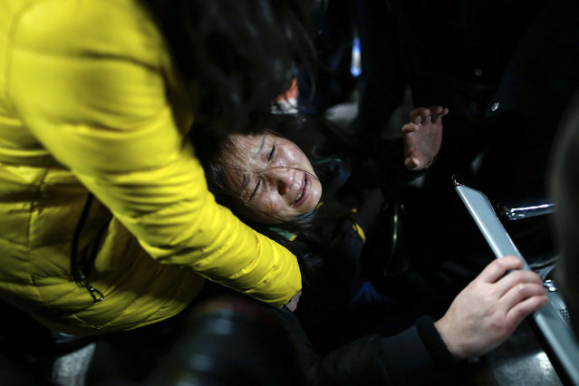 A woman grieves at a hospital where those injured by a stampede are being treated in Shanghai, China, Thursday January 1, 2015. Dozens died in a stampede during New Year's celebrations in downtown Shanghai, city officials said – the worst disaster to hit one of China's showcase cities in recent years. (Photo by AP Photo)