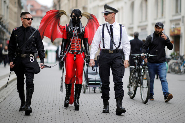 Participants of the Wave and Goth festival walk through the downtown pedestrian zone in Leipzig, Germany, May 18, 2018. (Photo by Axel Schmidt/Reuters)
