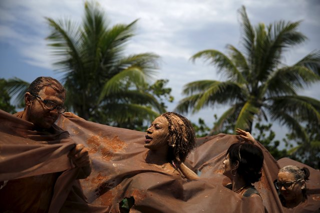 Protesters depicting mud perform during a rally held the day before the start of the Paris Climate Change Conference (COP21), in Rio de Janeiro, Brazil, November 29, 2015. (Photo by Pilar Olivares/Reuters)