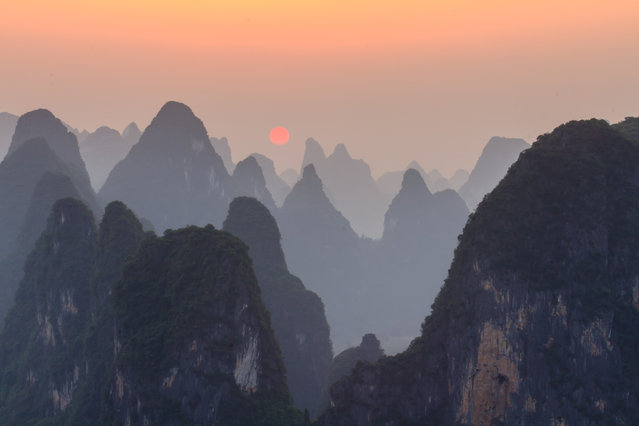 """Sunset at Li River"". Enjoy sunset on top of Lao Zhai mountain at the bank of Li River. Location: Xingping, Guangxi, China. (Photo and caption by James Bian/National Geographic Traveler Photo Contest)"