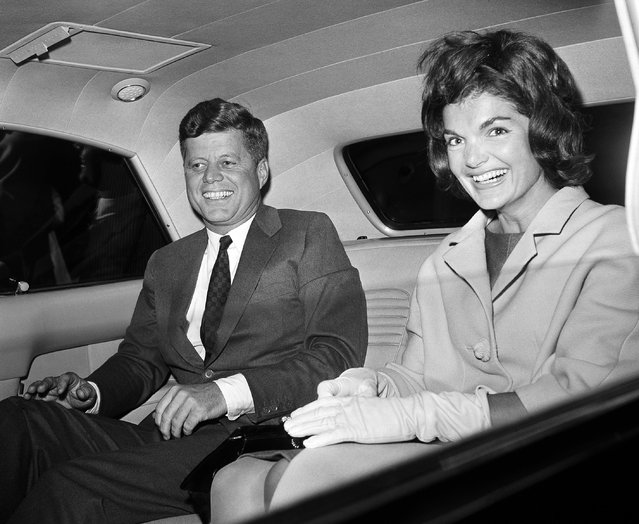President John F. Kennedy sits with his wife, Jacqueline, after her arrival back from a  trip to Greece as he met her at Washington National Airport on her return, June 15, 1961. The First Lady flew from Athens to Rome and New York aboard a commercial airliner, and from New York to Washington in the President's private plane, the Caroline.  President Kennedy, who has been suffering from sore back as a result of a tree-planting in Canada recently, did not get out of the White House car as they met. (Photo by John Rous/AP Photo)