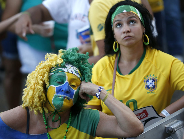 Brazil soccer fans react after their team lost 2-1 to Belgium in a World Cup quarter final soccer match in Rio de Janeiro, Brazil, Friday, July 6, 2018. Belgium knocked Brazil out of the World Cup and advanced to the semi-finals. (Photo by Silvia Izquierdo/AP Photo)