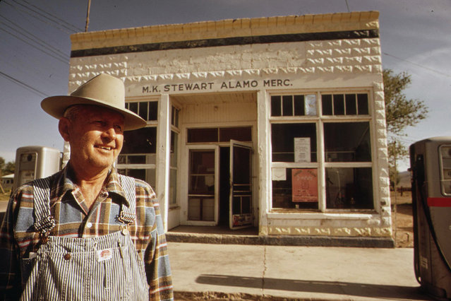 M.K. Stewart, owner of this general store in Alamo, Nevada, is one of several citizens who wears a TLD (thermo-luminescent dosimeter) to measure radioactive fallout from past atomic testing, May 1972. (Photo by Charles O'Rear/NARA via The Atlantic)
