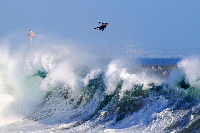Photographer: Benjamin Ginsberg. Athlete: Bobby Okvist. Location: The Wedge, Newport Beach, California. (Photo by Benjamin Ginsberg/Red Bull Illume via The Atlantic)