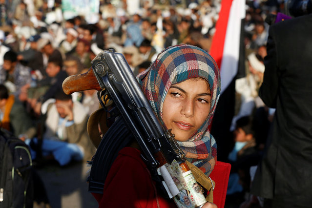 A girl carries a rifle as she attends a rally by followers of the Shi'ite Houthi movement commemorating the death of Imam Zaid bin Ali in Sanaa, Yemen October 26, 2016. (Photo by Khaled Abdullah/Reuters)