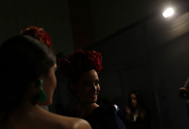 A model smiles backstage during the International Flamenco Fashion Show SIMOF in the Andalusian capital of Seville, February 6, 2015. (Photo by Marcelo del Pozo/Reuters)
