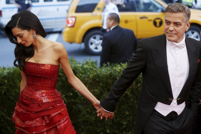 George Clooney and wife Amal Clooney pictured at the Metropolitan Museum of Art Costume Institute Gala 2015 in Manhattan, May 4, 2015. (Photo by Lucas Jackson/Reuters)