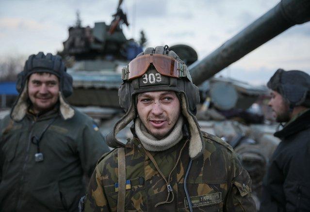 Ukrainian servicemen are seen near a tank near Artemivsk, eastern Ukraine, February 8, 2015. (Photo by Gleb Garanich/Reuters)