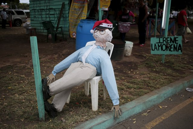 A handmade puppet is seen along the street in Managua, Nicaragua December 30, 2015. Nicaraguans traditionally burn handmade puppets as a way of saying goodbye to the old year and welcoming in the new. (Photo by Oswaldo Rivas/Reuters)