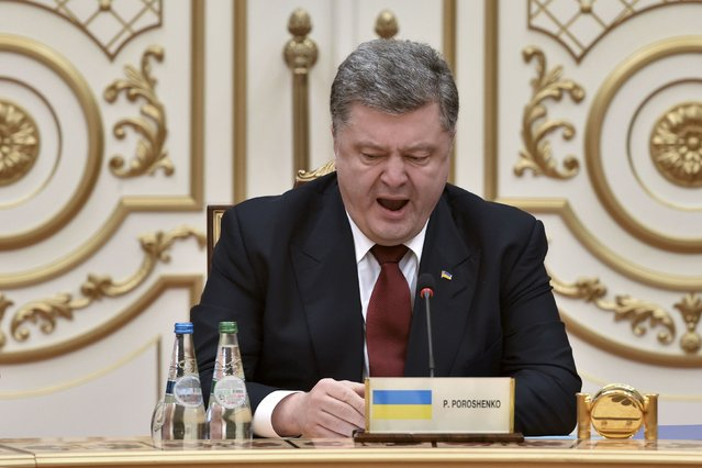 Ukraine's President Petro Poroshenko yawns as he takes part in peace talks on resolving the Ukrainian crisis in Minsk, February 11, 2015. (Photo by Kirill Kudryavtsev/Reuters)