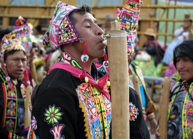 "An indigenous man plays the ""Tokoro"", a native instrument, during the Anata Andina (Andean carnival) parade in Oruro, February 12, 2015. (Photo by David Mercado/Reuters)"