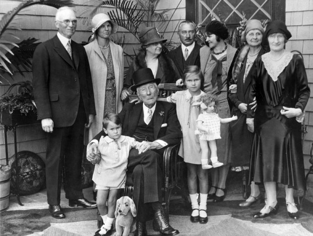 John D. Rockefeller, center, is surrounded by relatives and friends in Ormund Beach, Fla., on May 23, 1931.  From left to right are, John P. White, Cleveland, a close friend; Betty White; Fannie Evans, a second cousin; Max Oser and Mathilde Oser, daughter of the late Edith Rockefeller McCormick, visiting with her husband from Switzerland; Mrs. White; and Mrs. Mitchell, who often reads to Rockefeller.  Rockefeller is seated between Peter and Anita Oser, his great-grandchildren. (Photo by AP Photo/Engelbrecht)