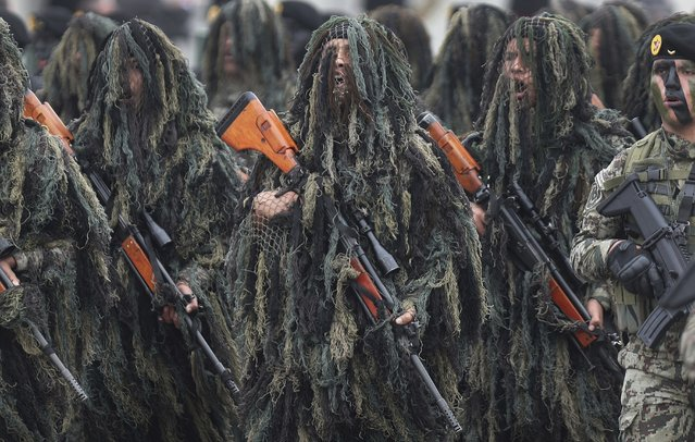 In this September 21, 2018 photo, members of the Peruvian Army Special Operations march in their Ghille suits during a military parade marking the Armed Forces' anniversary in Lima, Peru. (Photo by Martin Mejia/AP Photo)