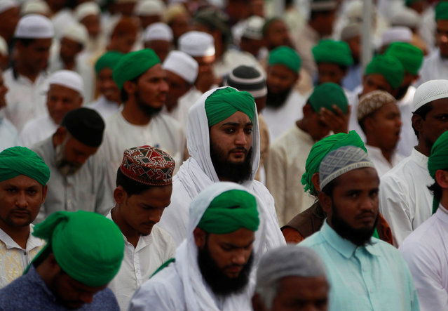 Muslim devotees offer Friday prayers during the three-day long annual Islami Ijtema (Islamic congregation) in Ahmedabad, India, December 2, 2016. (Photo by Amit Dave/Reuters)