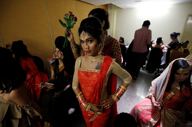 Contestants prepare at the backstage before the Miss Transqueen India 2018 transgender beauty pageant in Mumbai, India on October 7, 2018. (Photo by Francis Mascarenhas/Reuters)