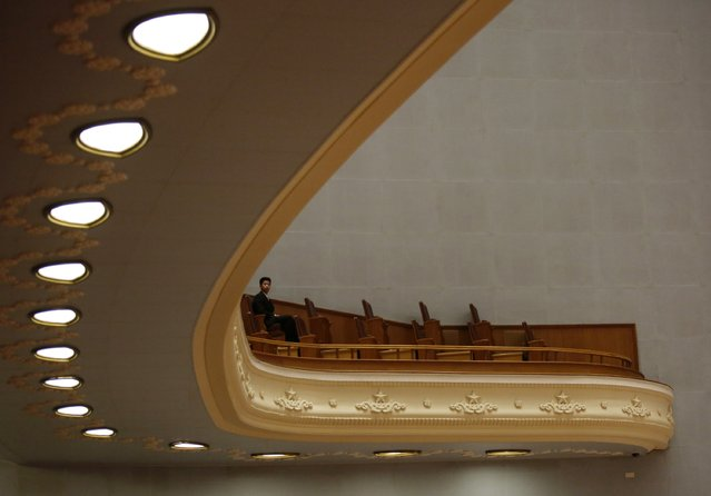 A security officer sits inside the Great Hall of the People during the opening session of Chinese People's Political Consultative Conference (CPPCC) in Beijing March 3, 2015. REUTERS/Barry Huang