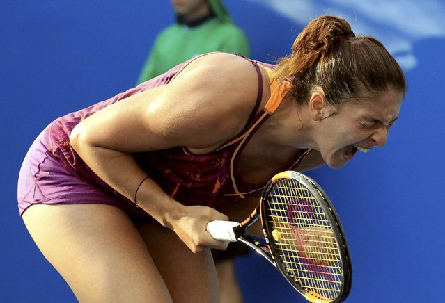 Russia's Margarita Gasparyan celebrates after winning her second round match against Japan's Kurumi Nara at the Australian Open tennis tournament at Melbourne Park, Australia, January 20, 2016. (Photo by John French/Reuters)