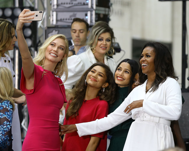 Former First Lady Michelle Obama takes a selfie with Karlie Kloss, Zendaya, Frieda Pinto and Kelly Clarkson on NBC Today Show celebration of International Day of the Girl on Rockefeller Plaza in New York City, New York on October 11, 2018. (Photo by Christopher Peterson/Splash News and Pictures)