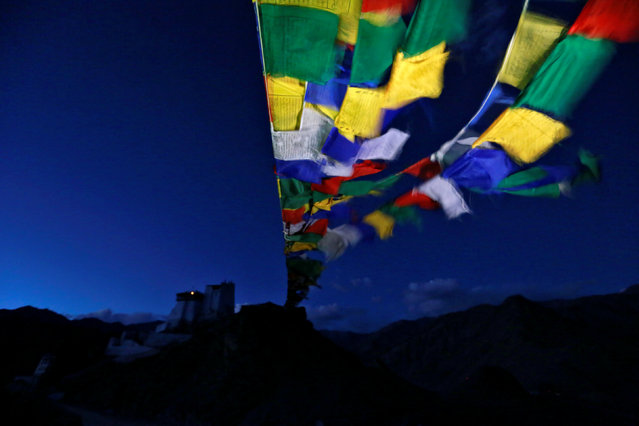 Prayer flags stretch towards Tsemo Monastery in the city of Leh, the largest town in the region of Ladakh, nestled high in the Indian Himalayas, September 26, 2016. (Photo by Cathal McNaughton/Reuters)