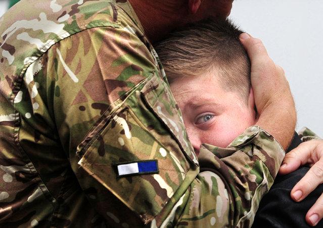 Regional Finalist – Anthony Chappel-Ross. CO Vaudin of 2 signal Regiment embraces his son Nicholas, 12, on his return. (Photo by Anthony Chappel-Ross/The Press, York)