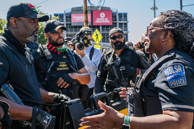A Tulsa police officer diffuses a conflict with members of the Black Panther Party and other armed demonstrators during commemorations of the 100th anniversary of the Tulsa Race Massacre on May 29, 2021 in Tulsa, Oklahoma. (Photo by Brandon Bell/Getty Images)