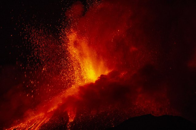 Lava erupts from a crater of Mt. Etna, Europe's largest active volcano, near Catania, in southern Italian island of Sicily, late Thursday, June 17, 2021. (Photo by Salvatore Allegra/AP Photo)