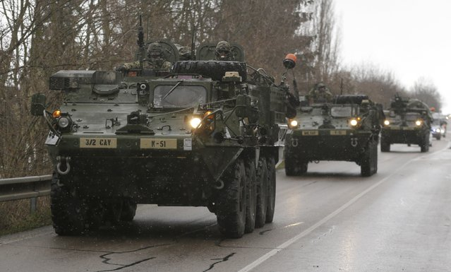 US army soldiers arrive with their convoy in Prague, Czech Republic, Monday, March 30, 2015. (Photo by Petr David Josek/AP Photo)