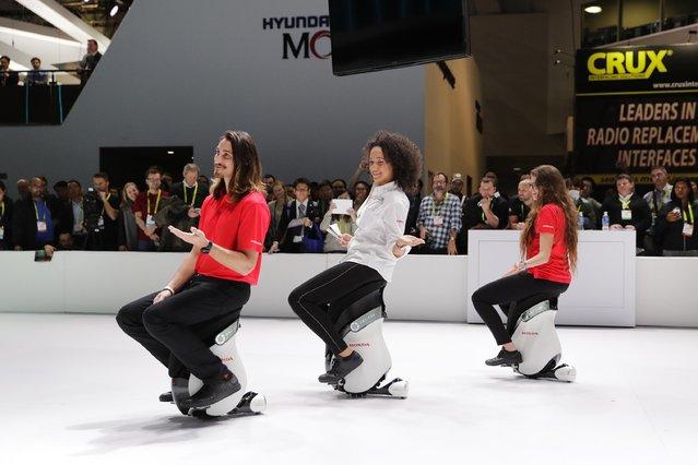 Models sit the Honda UNI-CUB electric scooters at CES International Thursday, January 5, 2017, in Las Vegas. (Photo by Jae C. Hong/AP Photo)