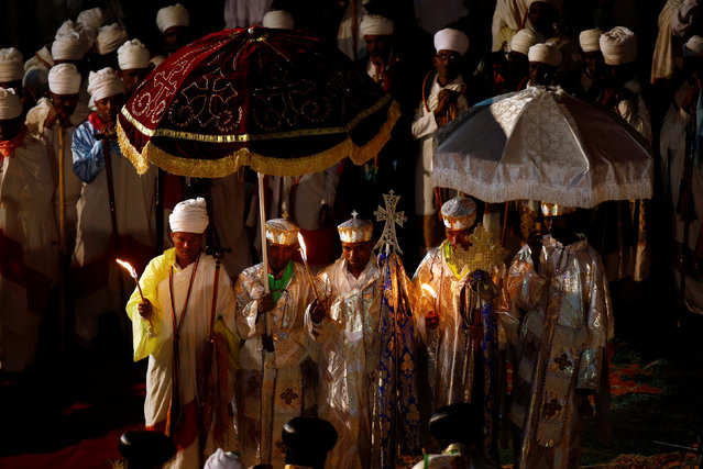 Ethiopian Orthodox choir members perform during the Ethiopian Christmas Eve celebration in Bete Maryam (House of Mary) monolithic church in Lalibela,  Ethiopia January 6, 2017. (Photo by Tiksa Negeri/Reuters)
