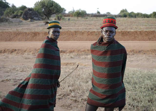 Karamojong tribesmen stand in town of Kaabong in Karamoja region, Uganda February 17, 2016. (Photo by Goran Tomasevic/Reuters)
