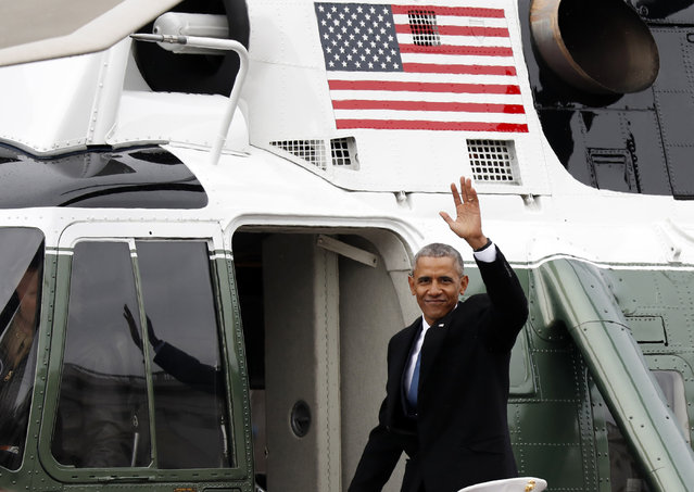 Former President Barack Obama waves as he departs the East Front of the U.S. Capitol, Friday, January 20, 2017 in Washington after the inauguration of President Donald Trump. (Photo by Alex Brandon/AP Photo)