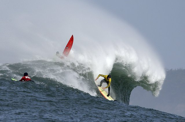 Ryan Seelbach rides a wave during the second heat of the first round of the Mavericks Invitational big wave surf contest Friday, January 24, 2014, in Half Moon Bay, Calif. (Photo by Eric Risberg/AP Photo)