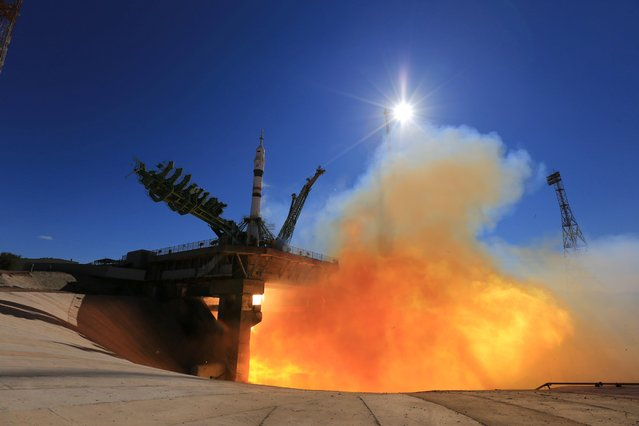 The Soyuz MS-19 spacecraft carrying the crew, formed of Russian cosmonaut Anton Shkaplerov, film director Klim Shipenko and actress Yulia Peresild, blasts off to the International Space Station (ISS) from the launchpad at the Baikonur Cosmodrome, Kazakhstan on October 5, 2021. (Photo by Roscosmos/Handout via Reuters)