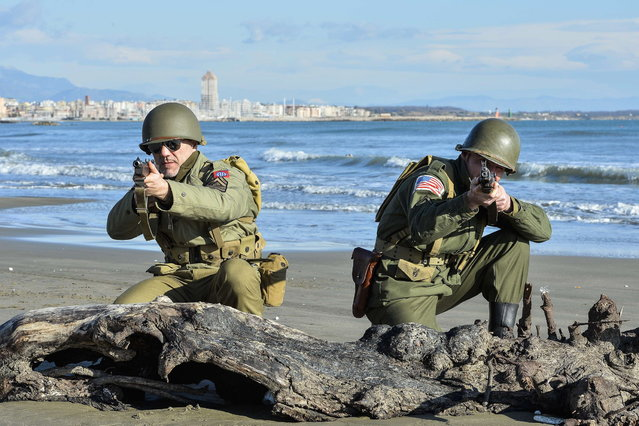 World War II enthusiasts take part in a re-enactament to mark the 70th anniversary of the Allied landings on Anzio beach, 52 km south of Rome, on January 25, 2014. (Photo by Andreas Solaro/AFP Photo)