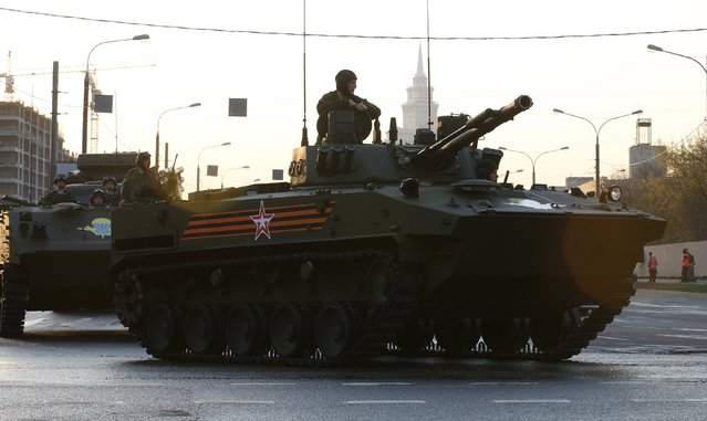 Russian servicemen drive a BMD04 amphibious infantry fighting vehicle along a street before a rehearsal for the Victory Day parade in Moscow, Russia, April 29, 2015. (Photo by Maxim Zmeyev/Reuters)
