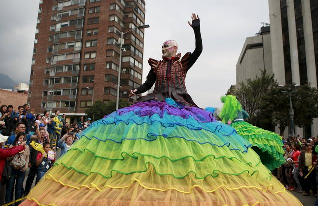 A performer takes part in a street parade as part of the opening ceremony of the Ibero-American Theater Festival in Bogota, Colombia, March 12, 2016. (Photo by John Vizcaino/Reuters)