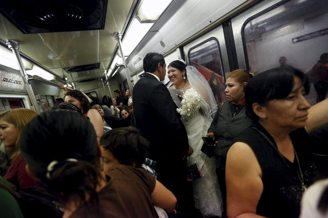 A newlywed couple travels inside a train in subway station after a mass wedding ceremony in which 2,016 couples participated, at Zocalo square in Mexico City, Mexico, March 19, 2016. (Photo by Edgard Garrido/Reuters)