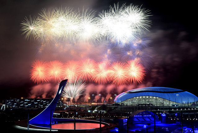 Fireworks explode around the Fisht Olympic Stadium at the end of the Closing Ceremony of the Sochi Winter Olympics on February 23, 2014 at the Olympic Park in Sochi. (Photo by Alexander Nemenov/AFP Photo)