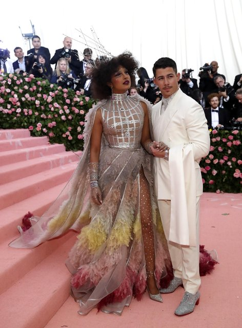"Newlyweds Priyanka Chopra and Nick Jonas attend the 2019 Met Gala celebrating ""Camp: Notes on Fashion"" at the Metropolitan Museum of Art on May 06, 2019 in New York City. (Photo by Mario Anzuoni/Reuters)"