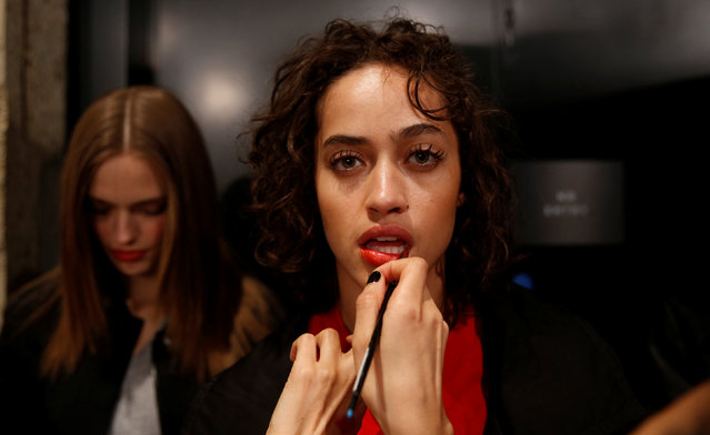 A model poses backstage at the Topshop Unique catwalk show during London Fashion Week in London, Britain February 19, 2017. (Photo by Neil Hall/Reuters)