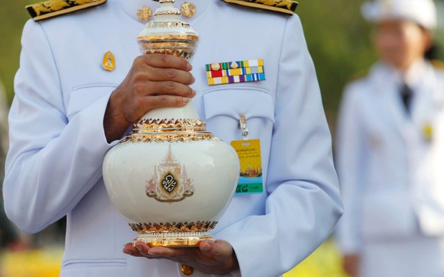 A Thai provincial governor transfers an ewer containing sacred water from across country to a consecration rite for the King's coronation ceremony at Wat Suthat Thepwararam royal temple in Bangkok, Thailand, 18 April 2019. The sacred water collected from more than 100 sources nationwide are ritually consecrated for a centuries-old ceremonial purification shower on 04 May 2019 in the three-day ancient elaborate traditional coronation ceremony for Thai King Maha Vajiralongkorn Bodindradebayavarangkun on 04 to 06 May 2019. The coronation is a formal ceremony to complete the monarch's accession to the throne. (Photo by Rungroj Yongrit/EPA/EFE)