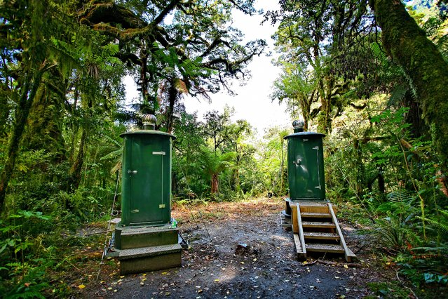 """Writing in the Spectator in 1908, poet Blanche Baughan described New Zealand's original Great Walk, the 33-mile waterfall- splattered, peak-punctuated Milford Track in Fiordland national park, as """"the finest walk in the world"""" – and she didn't even get to use these outhouses. (Photo by Chris R. Hasenbichler/Lonely Planet)"""