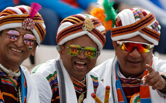 Indian cricket fans smile for the camera as they wait for the start of the Cricket World Cup match between South Africa and India at the Hampshire Bowl in Southampton, England, Wednesday, June 5, 2019. (Photo by Alastair Grant/AP Photo)