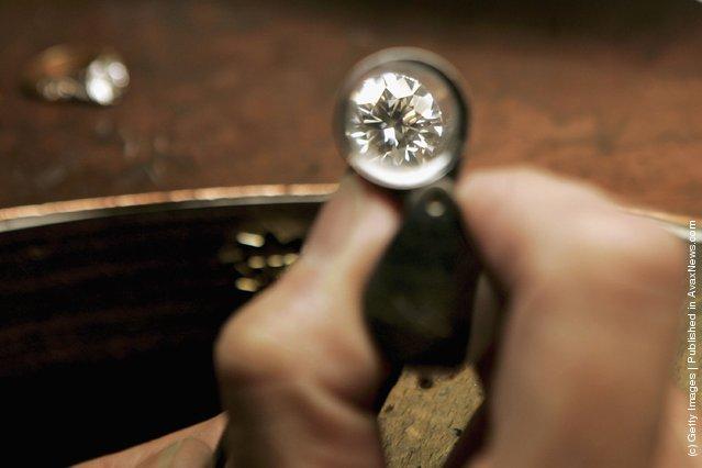 A jeweler examines a brilliant cut 1.01 carat diamond