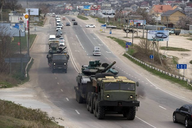 Ukrainian tanks are transported from their base in Perevalne, outside Simferopol, Crimea, Wednesday, March 26, 2014.  Ukraine has started withdrawing its troops and weapons from Crimea, now controlled by Russia. (Photo by Pavel Golovkin/AP Photo)