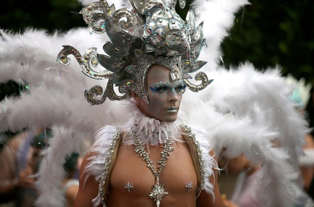 A participant prepares for the annual Gay and Lesbian Mardi Gras parade in Sydney, Saturday, March 4, 2017. (Photo by Rick Rycroft/AP Photo)