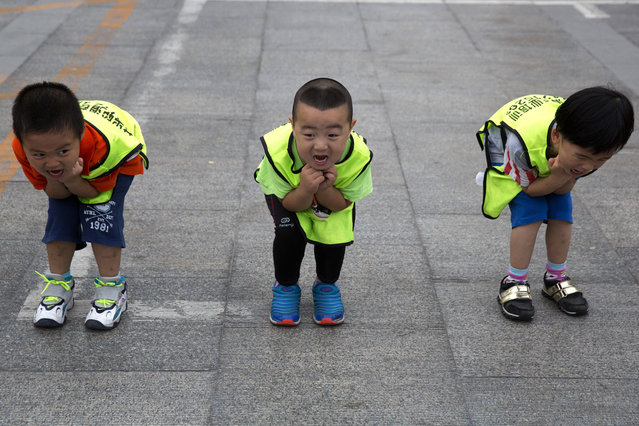 Children practice their postures during a roller blading class outside a park in Beijing, China, Wednesday, June 24, 2015. Roller blading has grown in popularity as instructors and equipment become more easily available in the Chinese capital. (Photo by Ng Han Guan/AP Photo)