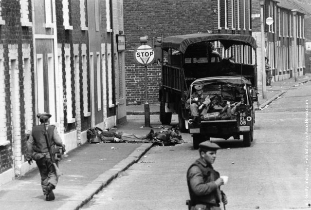 1970:  Armed British soldiers impose a curfew on the Falls Road in Belfast