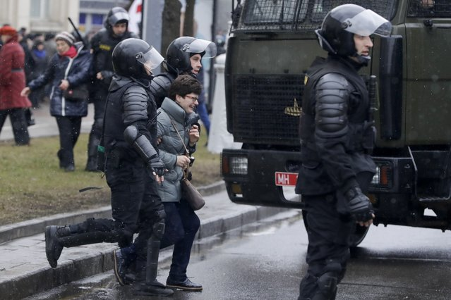 Belarus police detain a woman during an opposition rally in Minsk, Belarus, Saturday, March 25, 2017. (Photo by Sergei Grits/AP Photo)